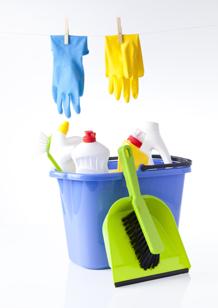 tidiness: cleaning detergents in blue bucket and washing gloves