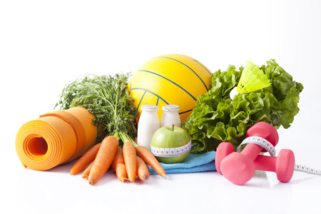 healthy food and sport equipment isolated on white Stock Photo