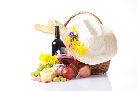 Summer picnic with a basket of food photo