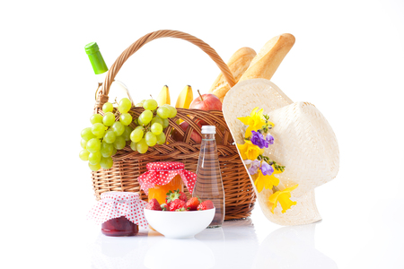 Dinner in picnic basket,on white background   photo