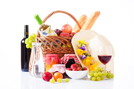 bottle of wine,fruits and summer hat isolated on white photo
