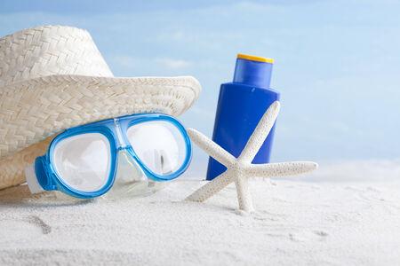 Sunglasses,sunblock and straw hat
