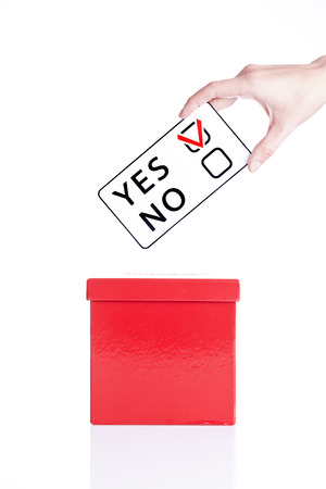local council election: weighing word Yes and No. Concept of decision making.