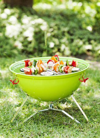barbecue skewers and grilled vegetables photo