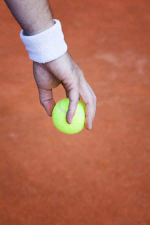 tennis ball, preparing for serve