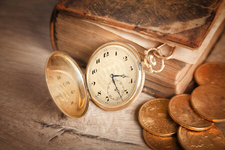 gambling background with dollars and golden watch photo