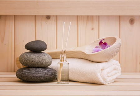 Massage therapy: zen stones and sauna accessories Stock Photo
