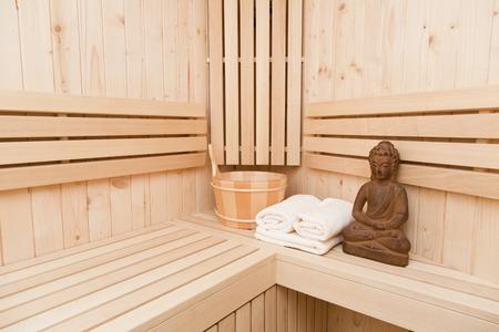 finnish sauna with buddha statue photo