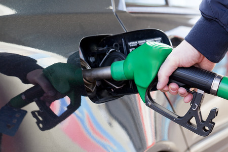 Male hand holding gasoline pump Stock Photo