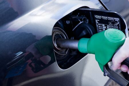 unleaded: filling up a car with petrol