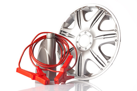 alloy: alloy wheel, motor oil and jump start cable Stock Photo