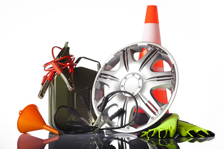 car accessories with fuel can and traffic cone