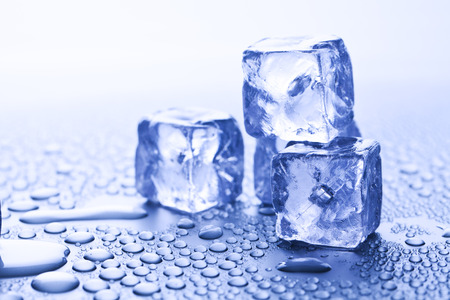 ice cubes and water drops over blue background Stock Photo