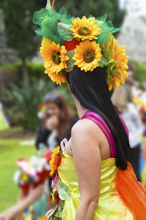participate: FUNCHAL MADEIRA APRIL 20 2015: Performers with colorful and elaborate costumes taking part in the Parade of Flower Festival on the Madeira Island Portugal.