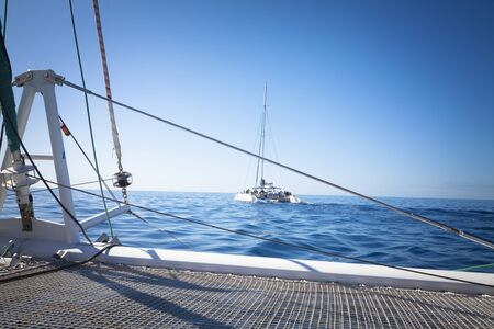 catamaran: Catamaran Sailing Boat with sunshine Stock Photo