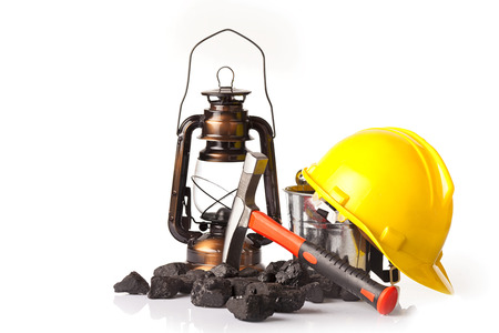 Mining tools with protective helmet ear muffspickaxe and oil lantern