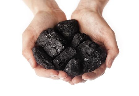 calorific: Holding lumps of charcoal in hands