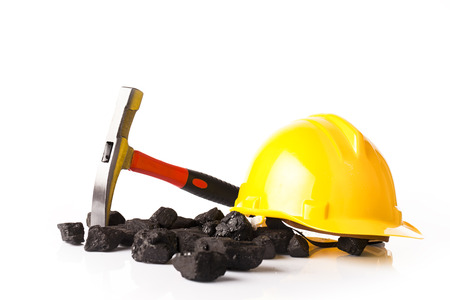 mining helmet and heap of coal Stockfoto