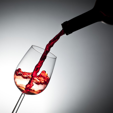 red wine pouring: Red wine pouring, splash effect Stock Photo
