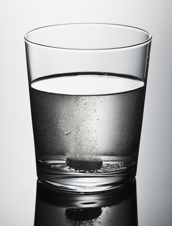 pain killer: pain killer, glass with effervescent tablet in water