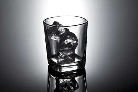 gass: gass with ice cubes for alcoholic drink Stock Photo