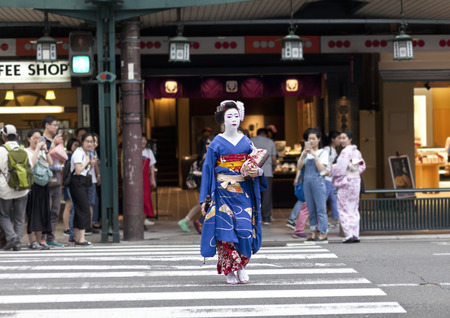 maiko: KYOTO, JAPAN - MAY 26.2016 Maiko in kimono performs in the Gion district on May 26, 2016 in Kyoto, Japan. Maiko is a geisha apprentice, left from the medieval times.