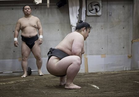 TOKYO, JAPAN - May 18, 2016: Japanese sumo wrestler training in Their stall in Tokyo on May 18. 2016