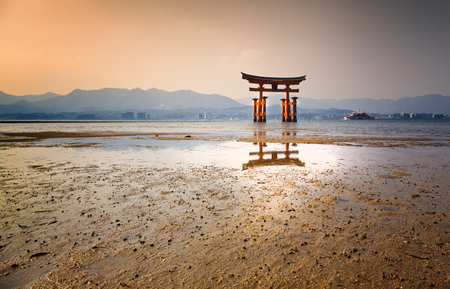 Itsukushima Shrine on Miyajima at sunset Stock Photo
