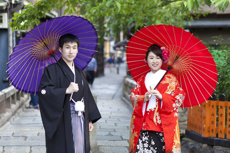 KYOTO, JAPAN- CIRCA MAY, 2016: Japanese couple in traditional cloths walking in the Gion district in Kyoto. Editorial