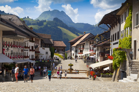 ch: GRUYERE, CH, CIRCA JULY, 2016: View of the main street in the Swiss town of Gruyeres (Switzerland) on a beautiful summer day. Gruyere gives its name to the well-known gruyere cheese