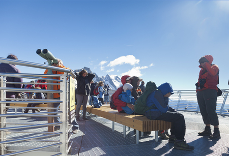 courmayeur: COURMAYEUR, IT - JULY 29, 2016: Unidentified people take a picture a panoramic terrace of Punta Helbronner new SKYWAY MONTE BIANCO terminal in Aosta Valley region of Italy. Editorial