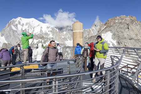 trecking: COURMAYEUR, IT - JULY 29, 2016: Unidentified people take a picture a panoramic terrace of Punta Helbronner new SKYWAY MONTE BIANCO terminal in Aosta Valley region of Italy. Editorial