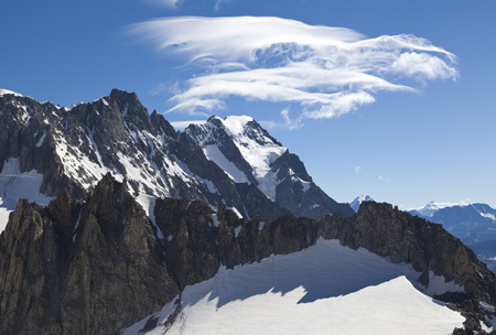 courmayeur: Panoramic view of Western alps whit Giants Tooth (Dent du Geant) from Helbronner roof of europe in Aosta Valley region of Italy.