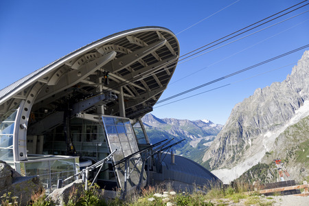 courmayeur: COURMAYEUR, IT - JULY 29, 2016: Cabin of new cableway SKYWAY MONTE BIANCO on the Italian side of Mont Blanc, Start from Entreves to Punta Helbronner at 3466 mt, in Aosta Valley region of Italy.