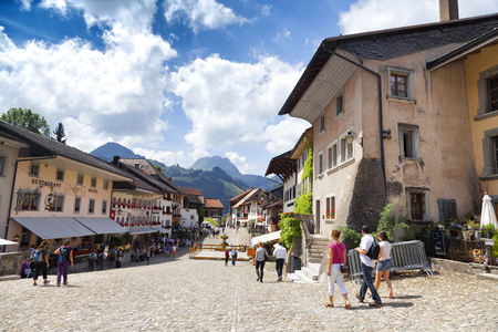 ch: GRUYERE, CH, CIRCA JULY, 2016: View of the main street in the Swiss town Gruyere (Switzerland) on a beautiful summer day. Gruyere gives its name to the well-known gruyere cheese
