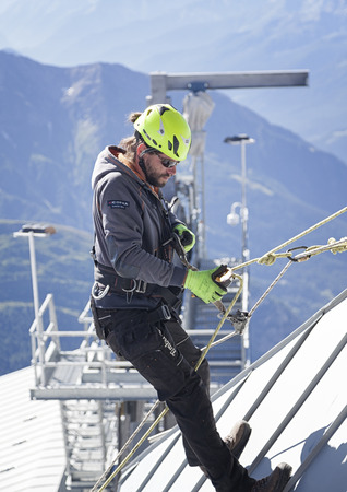 courmayeur: COURMAYEUR, ITALY - JULY 29, 2016: Young mountaineer practicing before cllimbing the Western Alps