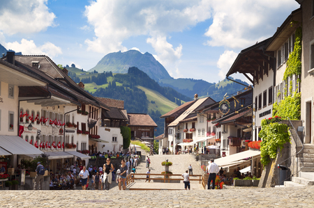 GRUYERES, CH, CIRCA JULY, 2016: View of the main street in the Swiss town of Gruyeres (Switzerland) on a beautiful summer day. Gruyere gives its name to the well-known gruyere cheese