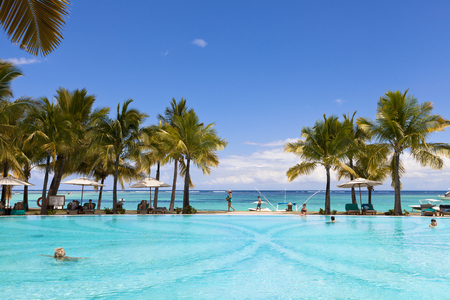 Swimming pool of five stars luxurious holiday resort on Mauritius. Favorite destnation honeymoon.