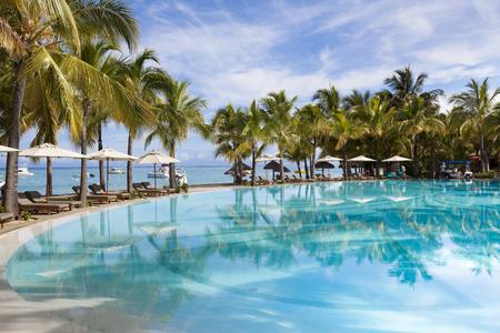 Swimming pool of five stars luxurious holiday resort on Mauritius. Favorite destnation honeymoon.