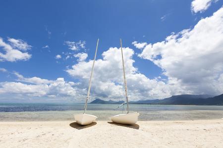 Sailboat on a tropical beach of Mauritius Stock Photo