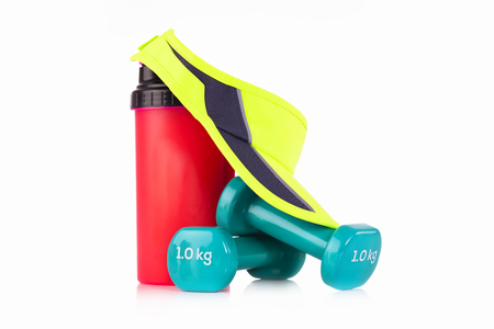 Green tennis headband cap and proteins blender bottle with a pair of blue dumbbells Fitness Stock Photo