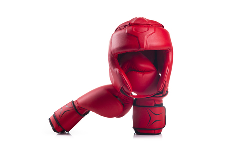 Red boxing head guard and a pair of red boxing gloves
