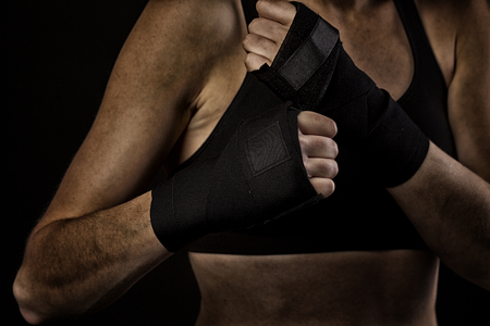 boxing tape: Female boxer wrapping hands with boxing tape Stock Photo
