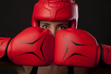 Female boxer in a self-defense posture