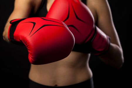 Punching with red boxing glove, fight concept Stock Photo