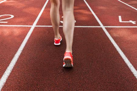 Sportswoman running on a racetrack