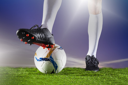 Soccer player with football Stock Photo