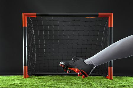 Striker shooting on goal Stock Photo