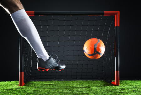 Soccer goal moment.Striker shooting on goal