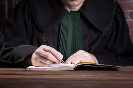 Lawyer writing on a notebook
